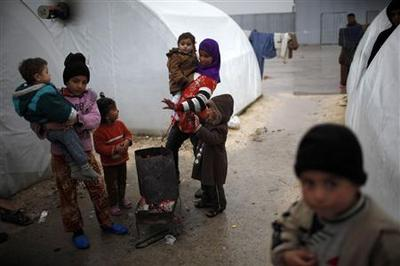 Breadlines and fuel shortages as winter grips Aleppo