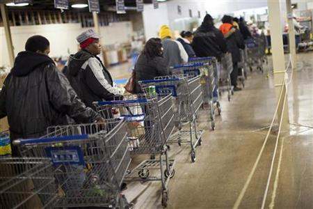 Clients wait in line to shop for food at the St. Vincent de Paul food pantry in Indianapolis, Indiana, November 27, 2012. REUTERS/Aaron P. Bernstein