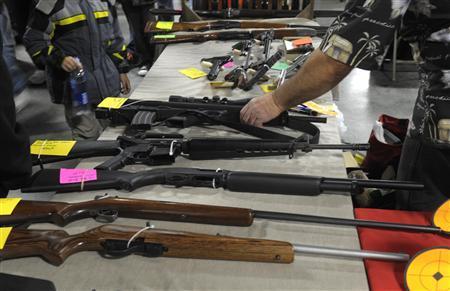 A dealer displays firearms for sale at a gun show in Kansas City, Missouri December 22, 2012. REUTERS-Dave Kaup
