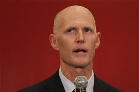 Republican Florida Governor Rick Scott speaks at a meeting of the Latin Builders Association in Miami, Florida January 27, 2012. REUTERS/Joe Skipper