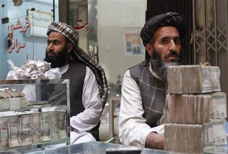 Afghan dealers wait for customers at a money market in Kandahar province, November 11, 2012. Washington this year has started attacking the Taliban's funding channels ahead of withdrawing most of its forces by 2014, ending the country's longest war. REUTERS/ Ahmad Nadeem