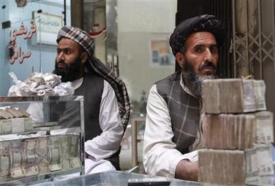Special Report: Stalking the Taliban in Afghan currenc...