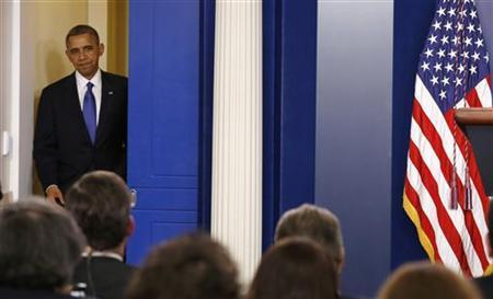 U.S. President Barack Obama arrives to speak about the fiscal cliff at the White House in Washington December 21, 2012. REUTERS/Kevin Lamarque