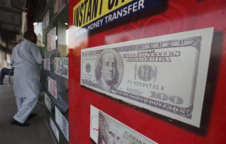 A man enters a currency exchange office in Islamabad November 26, 2012. REUTERS/Faisal Mahmood/Files