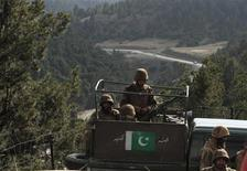 Pakistan army soldiers sit in a vehicle during their patrol at an army outpost in Kharang, about 40 km (21 miles) from Wana November 28, 2012. REUTERS/Faisal Mahmood