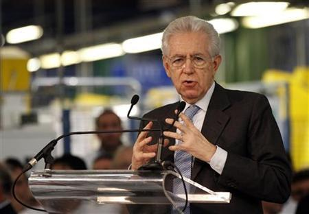 Italy's caretaker Prime Minister Mario Monti (C) gestures as he makes his speech during a visit to the Fiat car factory in the southern city of Melfi December 20, 2012. REUTERS/Ciro De Luca