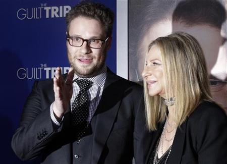 Barbra Streisand and Seth Rogen, stars of the new film ''The Guilt Trip'' pose as they arrive at the film's premiere in Los Angeles December 11, 2012. REUTERS/Fred Prouser