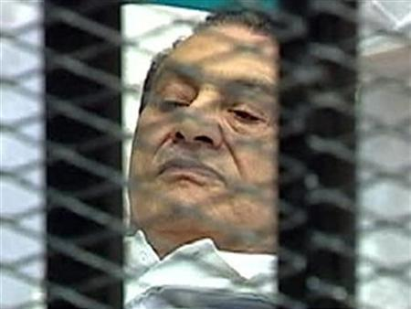 Former Egyptian President Hosni Mubarak is seen in the courtroom for his trial at the Police Academy in Cairo, in this still image taken from video August 3, 2011. REUTERS/Egypt TV via Reuters TV/Files