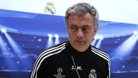 Real Madrid coach Jose Mourinho arrives for a news conference outside Madrid December 3, 2012. REUTERS/Andrea Comas