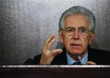 Italian caretaker Prime Minister Mario Monti gestures during an end of the year news conference in Rome December 23, 2012. Monti said on Sunday that he would be ready to offer his leadership to political forces that adopt his agenda of reforms the country needs. REUTERS/Alessandro Bianchi