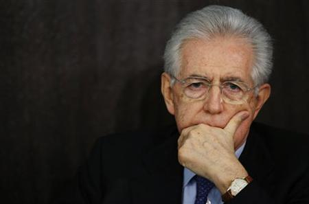 Italian caretaker Prime Minister Mario Monti attends an end of year news conference in Rome December 23, 2012. Monti said on Sunday he would be ready to run for a second term in next year's election if he was asked to do so by political forces that adopted his reform agenda. REUTERS/Alessandro Bianchi (ITALY - Tags: POLITICS ELECTIONS)