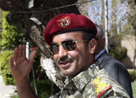 Brigadier General Ahmed Saleh, the son of Yemen's ex-president Ali Abdullah Saleh, gestures from the presidential palace in Sanaa in this February 19, 2011 file photo. REUTERS/Khaled Abdullah