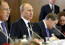 Russia's President Vladimir Putin (2nd L) sits at the opening of the EU-Russia Summit meeting in Brussels December 21, 2012. Putin and European Union leaders are likely to clash over issues ranging from Syria to trade, energy and human rights on Friday when Putin holds his first talks in Brussels since his re-election as president in May. REUTERS/Sebastien Pirlet (BELGIUM - Tags: POLITICS BUSINESS)