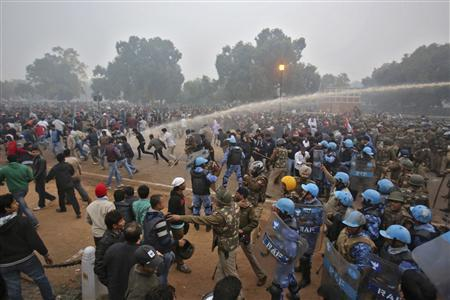 Police chase and use water canons on demonstraters during a protest in front of India Gate in New Delhi December 23, 2012. The Indian government moved on Sunday to stamp out protests that have swelled in New Delhi since the gang-rape of a young woman, banning gatherings of more than five people, but still thousands poured into the heart of the capital to vent their anger. REUTERS/Adnan Abidi