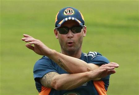 Australia's Michael Clarke stretches during a practice session in Colombo September 14, 2011. REUTERS/Dinuka Liyanawatte/Files