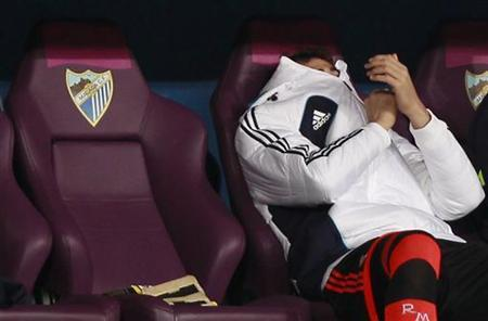 Real Madrid's goalkeeper Iker Casillas sits in the bench during their Spanish First Division soccer match against Malaga at La Rosaleda stadium in Malaga December 22, 2012. REUTERS/Marcelo del Pozo