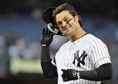 New York Yankees' Nick Swisher reacts after grounding out against the Baltimore Orioles during the second inning in Game 5 of their MLB ALDS baseball playoff series in New York, October 12, 2012. REUTERS/Ray Stubblebine
