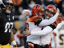 Cincinnati Bengals Kevin Huber congratulates kicker Josh Brown on his game-winning field goal against the Pittsburgh Steelers at the end of the fourth quarter of their NFL football game in Pittsburgh, Pennsylvania, December 23, 2012. REUTERS/Jason Cohn