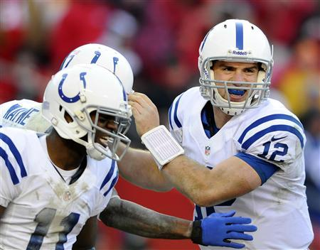 Indianapolis Colts quarterback Andrew Luck (R) and wide receiver Donnie Avery (L) congratulate wide receiver Reggie Wayne on his go-ahead touchdown during the second half of Colts' win in their NFL football game in Kansas City, Missouri December 23, 2012. REUTERS/Dave Kaup