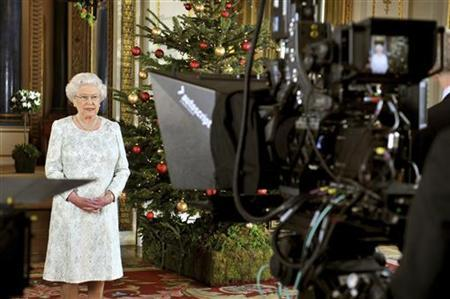 Britain's Queen Elizabeth records her Christmas message in 3-D from the White Drawing Room of Buckingham Palace in central London December 7, 2012 in a photo released December 24, 2012. REUTERS/John Stillwell/Pool