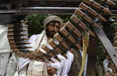 Taliban militants hand over their weapons after joining the Afghan government's reconciliation and reintegration program, in Herat province May 14, 2012. REUTERS/Mohammad Shoiab