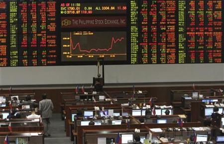 A screen displaying market data is seen inside the Philippine Stock Exchange in Manila's Makati financial district February 21, 2012. REUTERS/Romeo Ranoco