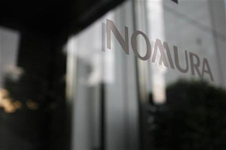 Nomura Holdings' logo is seen outside a Nomura Securities branch in Tokyo June 18, 2012. REUTERS/Issei Kato