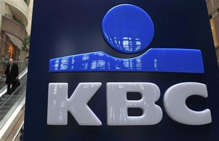 The logo of Belgian banking and insurance group KBC is seen at the entrance of the company's headquarters in Brussels February 9, 2012. REUTERS/Yves Herman