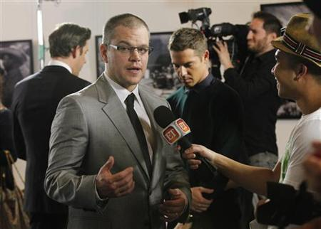 Cast member Matt Damon is interviewed at the premiere of ''Promised Land'' at the Directors Guild of America (DGA) in Los Angeles, California December 6, 2012. REUTERS/Mario Anzuoni