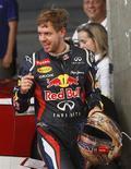Los aficionados a la Fórmula 1 han aprendido a esperar lo inesperado, y aunque 2012 terminó con Sebastian Vettel y su escudería Red Bull como campeones por tercer año consecutivo, fue un año previsiblemente impredecible. En la imagen, Vettel en la carrera de Bangkok el 16 de diciembre de 2012. REUTERS/Chaiwat Subprasom