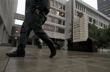 Rain falls outside a federal courthouse as New Orleans police officers convicted in the deadly shootings of unarmed civilians on the Danziger Bridge and a subsequent cover-up after Hurricane Katrina, await sentencing in New Orleans in this file photo dated April 4, 2012. REUTERS/Sean Gardner