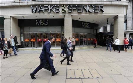 Pedestrians walk past the Marble Arch branch of Marks and Spencer in central London June 8, 2012. REUTERS/Paul Hackett