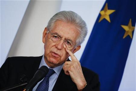 Italian caretaker Prime Minister Mario Monti gestures during an end of year news conference in Rome December 23, 2012. Monti said on Sunday he would be ready to run for a second term in next year's election if he was asked to do so by political forces that adopted his reform agenda. REUTERS/Alessandro Bianchi