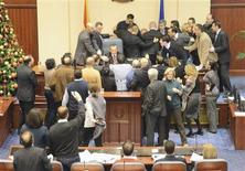 Macedonian deputies and members of opposition Social-Democratic Alliance of Macedonia (SDSM) clash with Parliament security as they try to protect parliament speaker Trajko Veljanovski in Skopje December 24, 2012. REUTERS/Viktor Popovski