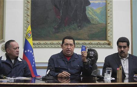 Venezuelan President Hugo Chavez speaks next to Vice President Nicolas Maduro (R) and National assembly president Diosdado Cabello (L) during a national broadcast at Miraflores Palace in Caracas December 8, 2012. REUTERS/Miraflores Palace/Handout
