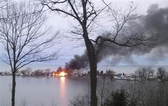 A fire burns on Lake Road after a suspect shot four firefighters responding to the blaze in Webster, New York, December 24, 2012. REUTERS/WHEC/Christine VanTimmeren/Handout