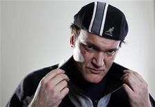"""Veinte años después de que Quentin Tarantino presentara su primera película, """"Reservoir Dogs"""", el director ha vuelto la mirada hacia la historia de la esclavitud en Estados Unidos, hilando una historia repleta de sangre, a su más puro estilo, en """"Django desencadenado"""". En la imagen,, Tarantino en la promoción de """"Django desencadenado"""" en Nueva York el 16 de noviembre de 2012. REUTERS/Carlo Allegri"""