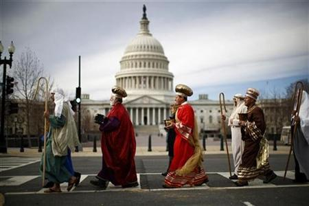 Actors dressed as (L-R) Joseph and the Three Wise Men, part of a live-human nativity scene, stroll past the U.S. Capitol Building after demonstrating outside the nearby Supreme Court in Washington, December 5, 2012. REUTERS/Jason Reed