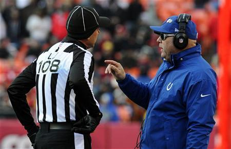 Indianapolis Colts head coach Chuck Pagano (R) speaks with line judge Gary Arthur during the second half of the Colts' win against the Kansas City Chiefs in their NFL football game in Kansas City, Missouri December 23, 2012. REUTERS/Dave Kaup