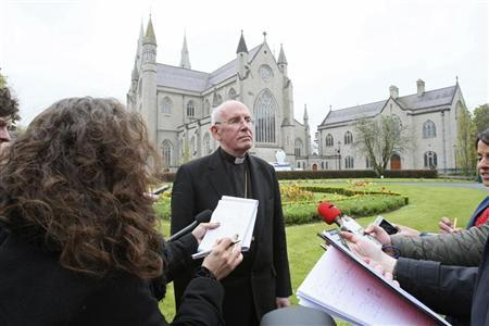 Cardinal Sean Brady speaks to members of the media outside Armagh cathedral in northern Ireland May 2, 2012.REUTERS/Stringer