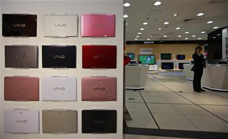Sony Corp's VAIO laptop cases are displayed on a wall as an employee waits for customers at a Sony store in Beijing December 25, 2012. REUTERS/Petar Kujundzic