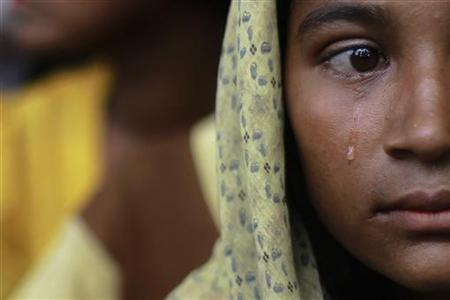 A Muslim woman, displaced by recent violence in Kyukphyu township, cries after arriving at the Thaechaung refugee camp outside of Sittwe in this October 28, 2012 file photo. REUTERS/Soe Zeya Tun/Files
