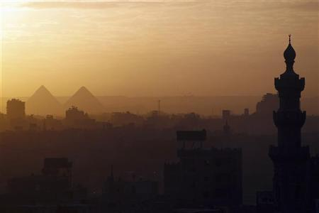 A general view of mosques and the great pyramids before sunset in Cairo, December 5, 2012. REUTERS/Amr Abdallah Dalsh