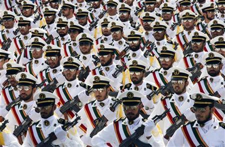 Members of the Iranian Revolutionary Guard Navy march during a parade to commemorate the anniversary of the Iran-Iraq war (1980-88), in Tehran September 22, 2011. REUTERS/Stringer/Files