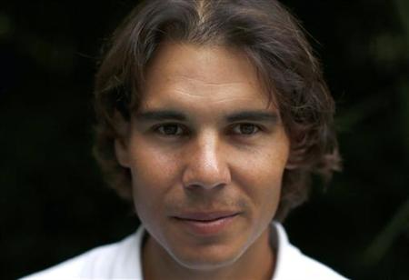 Spanish tennis player Rafa Nadal poses after an interview with Reuters in Madrid, September 18, 2012. REUTERS/Paul Hanna/Files