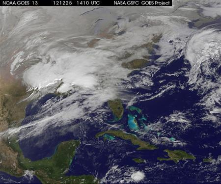 Storm clouds are seen on the east coast of the United States in this NASA handout satellite image taken at 1415 GMT, December 25, 2012. A strong winter storm was expected to bring a white Christmas morning to millions of Americans Tuesday - but also high winds and even the risk of tornadoes for some. REUTERS/NASA/NOAA/GOES Project/Handout