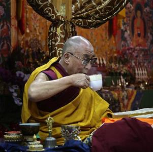 Tibetan spiritual leader the Dalai Lama takes a drink during a teaching session on the first day of the Kalachakra festival in Bodhgaya January 1, 2012. The Kalachakra is a 10-day festival comprising Buddha teachings and meditations, taking place at Bodhgaya where Buddha is said to have gained enlightenment. REUTERS/Jitendra Prakash/Files