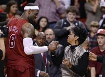 Miami Heat's LeBron James (L) is congratulated by recording artist Gladys Knight (R) following their NBA basketball game against the Oklahoma City Thunder in Miami, Florida, December 25, 2012. REUTERS/Rhona Wise