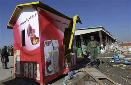 An Afghan security personnel stands inside a fruit factory which was destroyed by a car suicide bomb attack, in Kabul December 21, 2012. REUTERS/Omar Sobhani