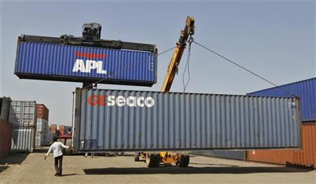Mobile cranes prepare to stack containers at Thar Dry Port in Sanand in Gujarat October 1, 2012. REUTERS/Amit Dave/Files